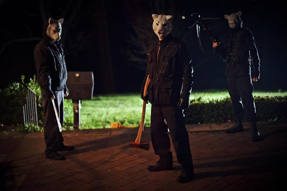 "This film publicity image released by Lionsgate shows a scene from ""You're Next."" (AP Photo/Lionsgate, Corey Ransberg)"