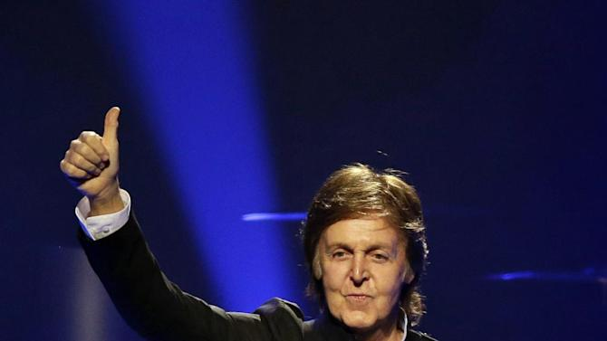 """FILE - This May 18, 2013 file photo shows Paul McCartney performing during the first U.S concert of his """"Out There!"""" world tour in Orlando, Fla.  The tour wraps on Aug. 14 in Canada. (AP Photo/John Raoux, file)"""