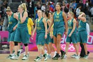 Australian players react at the end of the Women&#39;s preliminary round group B basketball match of the London 2012 Olympic Games France vs Australia at the basketball arena in London. France won 74 to 70