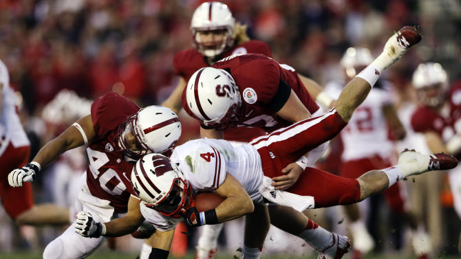 Wisconsin wide receiver Jared Abbrederis is hit by Stanford linebacker Joe Hemschoot (40) during the second half of the Rose Bowl NCAA college football game, Tuesday, Jan. 1, 2013, in Pasadena, Calif. Stanford won 20-14. (AP Photo/Lenny Ignelzi)