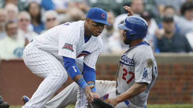 Los Angeles Dodgers' Matt Kemp reaches third base past Chicago Cubs third baseman Luis Valbuena on a single by Justin Turner during the seventh inning of a baseball game on Saturday, Sept. 20, 2014, in Chicago. (AP Photo/Andrew A. Nelles)