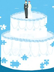white wedding cake on a blue background with a couple cake topper