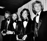 In this Friday, Jan. 13, 1979 file photo, members of the Bee Gees pose with Barry Manilow, far right, at the American Music Awards in Los Angeles, Ca. The brothers Gibb, from left, Barry, Maurice, and Robin, won awards for favorite popular group and favorite soul album for &quot;Saturday Night Fever.&quot; A representative said on Sunday, May 20, 2012, that Robin Gibb has died. He was 62. (AP Photo/Nick Ut, File)