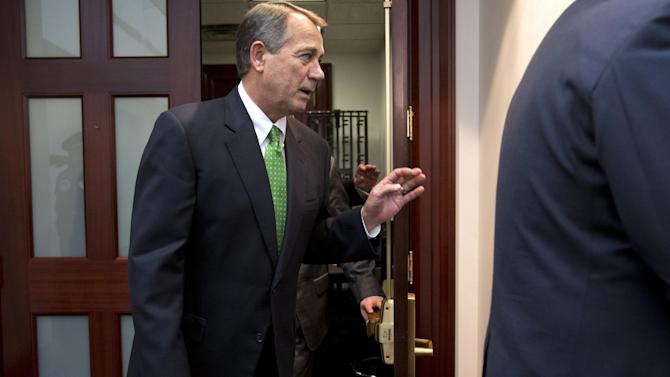 """House Speaker John Boehner of Ohio leaves a Republican caucus on Capitol Hill in Washington, Tuesday, Jan. 1, 2013. Squarely in the spotlight, House Republicans leaders shopped a Senate-approved """"fiscal cliff"""" compromise to rank-and-file colleagues on New Year's Day and heard concerns that the accord lacked sufficient spending cuts. Vice President Joe Biden tried rallying House Democrats behind the deal in a separate meeting. (AP Photo/Jacquelyn Martin)"""