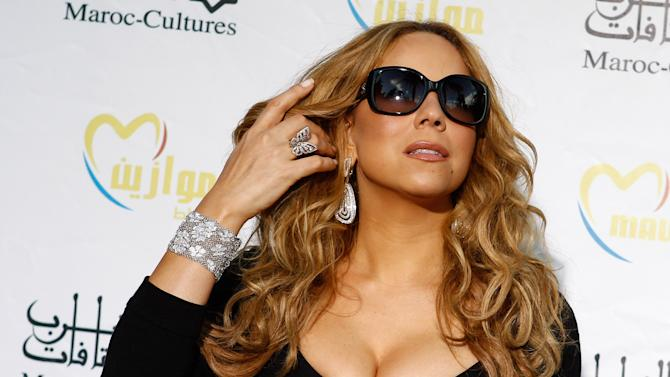 "In this May 25, 2012 file photo, singer Mariah Carey poses before a press conference, during the Mawazine Festival in Rabat, Morocco. Mariah Carey, Usher and Celine Dion are among the heady names being tossed around as ""American Idol"" replacement judges after the exits of judges Steven Tyler and Jennifer Lopez. (AP Photo/Abdeljalil Bounhar, File)"