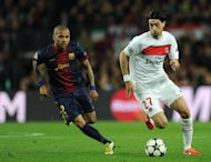 Barcelona defender Dani Alves (L) and PSG's Javier Pastore are pictured during their Champions League match on April 10, 2013. Barcelona went behind for the first time in the tie when Pastore struck shortly after half-time
