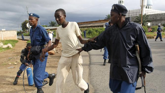 Riot police detain a resident participating in street protests in Burundi's capital Bujumbura