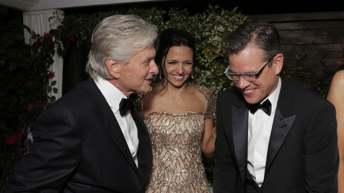 """AP10ThingsToSee - Actors Michael Douglas, Luciana Barroso and Matt Damon laugh at a party for the movie """"Behind the Candelabra"""" at the 66th international film festival, in Cannes, France on Tuesday, May 21, 2013. (Photo by Todd Williamson/Invision/AP)"""