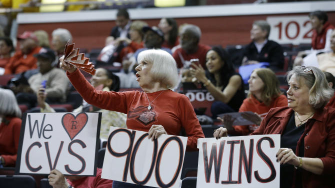 Fans celebrate as Rutgers head coach C. Vivian Stringer wins her 900th NCAA college basketball game on Tuesday, Feb. 26, 2013, in Piscataway, N.J. Rutgers defeated South Florida 68-56. (AP Photo/Mel Evans)