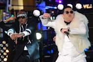 "South Korean singer Psy (right) performs with US singer MC Hammer during New Year's Eve celebrations in Times Square in New York on December 31, 2012. China's hugely popular Lunar New Year television galas aim to woo even more viewers this year with foreign megastars including Celine Dion and ""Gangnam Style"" pop sensation Psy, state media said Thursday"