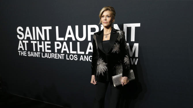 Actress Fonda poses as she arrives for the Saint Laurent fall collection fashion show at the Hollywood Palladium in Los Angeles