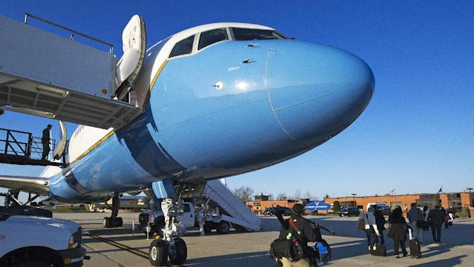 Passengers traveling abroad with Secretary of State John Kerry disembark after a mechanical failure of the plane Saturday, April 6, 2013, at Andrews Air Force Base in Maryland. A backup aircraft was brought in to replace the plane.  (AP Photo/Paul J. Richards, Pool)