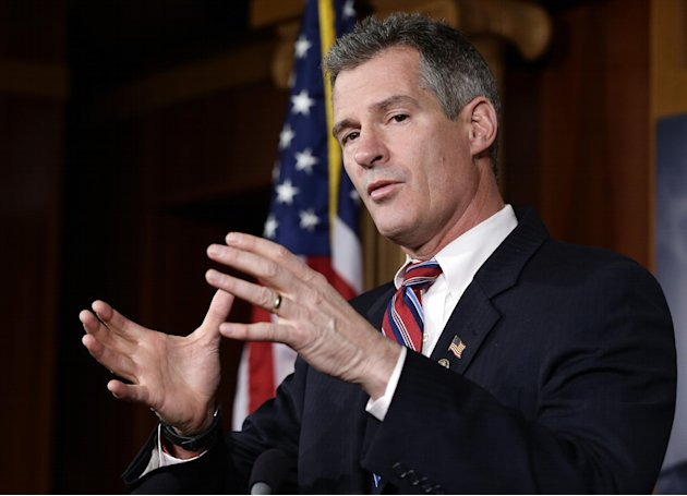 FILE - In this Nov. 13, 2012 file photo, Sen. Scott Brown, R-Mass., speaks during a media availability, on Capitol Hill in Washington. Brown, who was defeated in his re-election bid, said Friday, Feb. 1, 2013 that he will not run for the Senate seat vacated by John Kerry, who was named secretary of state. (AP Photo/Alex Brandon, File)