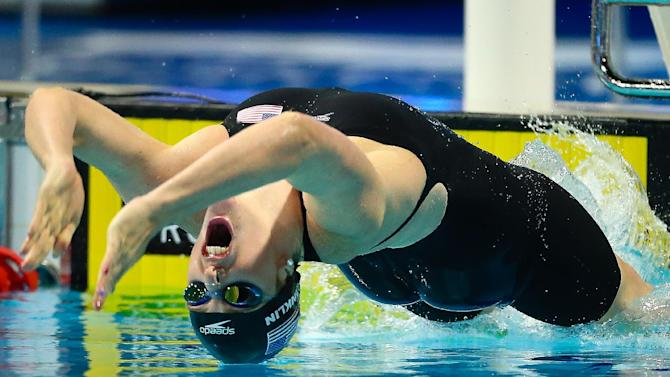 Missy Franklin of the US swims during the women's 100m backstroke final at the Gold Coast Aquatic Centre on August 21, 2014