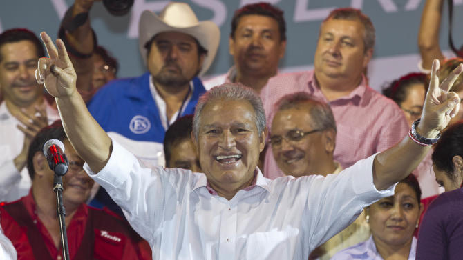 Presidential candidate Salvador Sanchez Ceren, of the ruling Farabundo Marti National Liberation Front (FMLN), celebrates after partial results were announced by election authorities in San Salvador, El Salvador, Sunday, March 9, 2014. El Salvador's too-close-to-call presidential runoff election has raised competing claims of victory from Ceren, a former fighter for leftist guerrillas and the candidate of the once long-ruling conservative party that fought a civil war from 1980 to 1992, Norman Quijano but preliminary returns from nearly all polling stations showed Quijano a few thousands votes behind Ceren. (AP Photo/Esteban Felix)