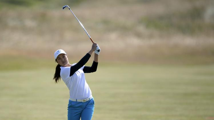 Miki Saiki of Japan plays her second shot at the 10th hole during the women's British Open golf tournament at Royal Birkdale Golf Club in Southport