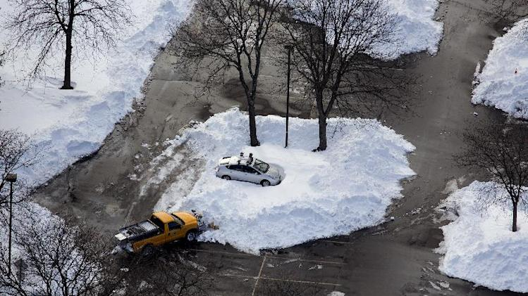 A car in a Hamden, Connecticut parking lot is isolated by snow Sunday, Feb. 10, 2013, in the aftermath of a storm that hit Connecticut and much of the New England states. (AP Photo/Craig Ruttle)