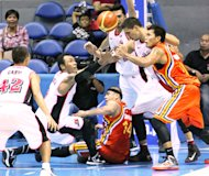 Players from both teams go for the loose ball. (PBA Images)