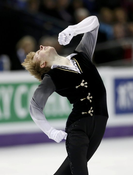 Kevin Reynolds of Canada performs his men's free program at the ISU World Figure Skating Championships in London