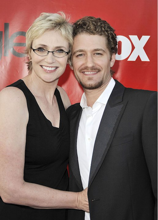 "Jane Lynch and Matthew Morrison pose at the premiere screening of Fox TV's ""Glee"" at Willow School on September 8, 2009 in Culver City, California."