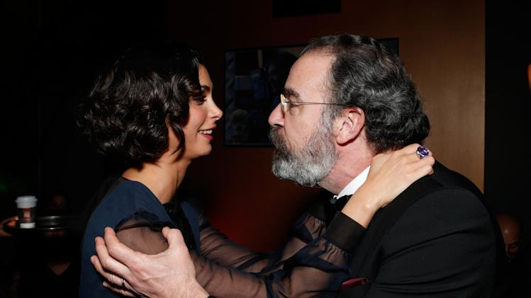 Morena Baccarin, left, and Mandy Patinkin attend the Fox Golden Globes Party on Sunday, January 13, 2013, in Beverly Hills, Calif. (Photo by Todd Williamson/Invision for Fox Searchlight/AP Images)