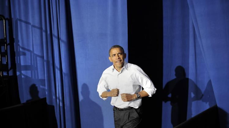 President Barack Obama arrives at Mentor High School in Mentor, Ohio, Saturday Nov. 3, 2012 for a campaign rally. (AP Photo/Jerome Delay)