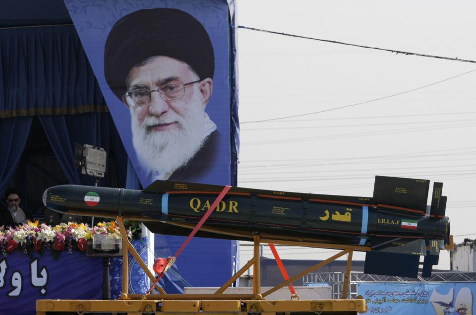 A Qadr missile is displayed during a military parade commemorating National Army Day in front of the mausoleum of the late revolutionary founder Ayatollah Khomeini, as a portrait of supreme leader Ayatollah Ali Khamenei is seen, background, outside Tehran, Iran, Tuesday, April 17, 2012. (AP Photo/Vahid Salemi)