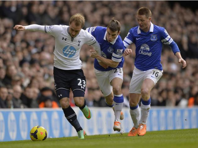 Tottenham Hotspur's Eriksen is challenged by Everton's Coleman and McCarthy during their English Premier League soccer match at White Hart Lane in London