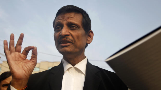 Manohar Lal Sharma, lawyer for one of the accused, speaks to the journalists outside the Saket district court complex where the accused in a gang rape are to be tried, in New Delhi, India, Monday, Jan. 14, 2013. The lawyer for one of the five men charged in the fatal gang rape of a woman on a moving New Delhi bus said Monday that his client is a minor and asked a court to order a medical test to determine his age. (AP Photo/Tsering Topgyal)