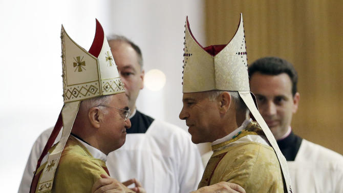 Salvatore J. Cordileone, right, is embraced by Archbishop Carlo Maria Vigano, Vatican Ambassador to the U.S. during a ceremony to install Cordileone as the new archbishop of San Francisco at the Cathedral of St. Mary of the Assumption in San Francisco, Thursday,  Oct. 4, 2012. (AP Photo/Marcio Jose Sanchez, Pool)