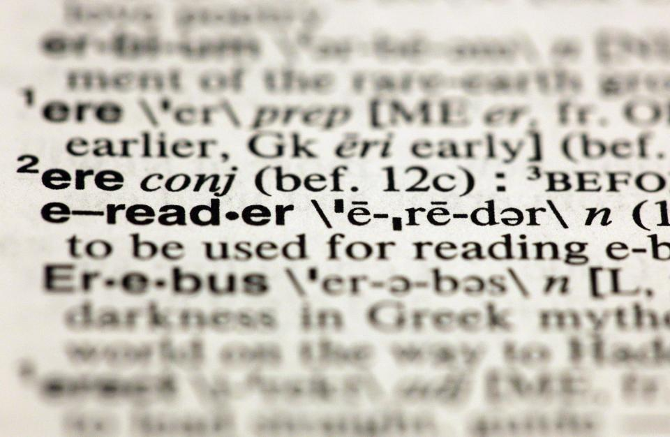 "The entry ""e-reader,"" photographed in New York,  Friday, Aug. 10, 2012, is one of the 15 new additions in the 11th edition of Merriam-Webster's Collegiate Dictionary. (AP Photo/Richard Drew)"