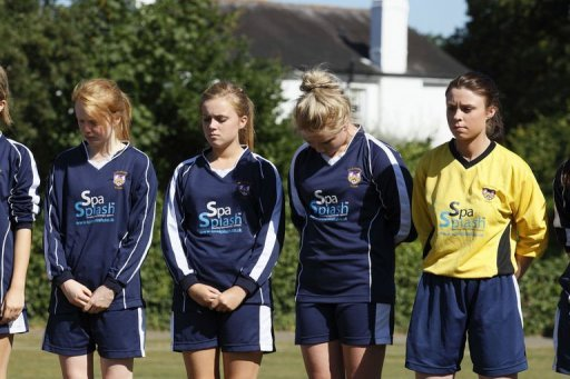 <p>A minute's silence is held on Claygate recreation grounds by local youth football teams in remembrance for a family shot dead in their car in the French Alps, in Claygate, in south-east England, on September 9. The four-year-old girl who survived the execution-style killing of her family was due to return to Britain as police again quizzed relatives and scoured the family home.</p>