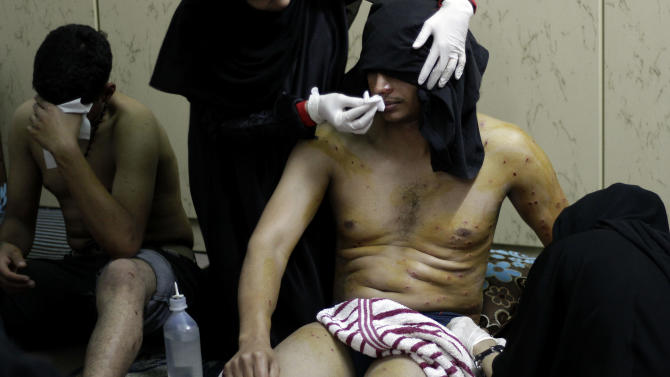 Wounded Bahraini anti-government protesters are treated at a house after shot with pellets fired by riot police during clashes in Daih, Bahrain, on Thursday, Feb. 14, 2013, the second anniversary of the start of a pro-democracy uprising in the Gulf island kingdom. Protests began at daybreak in opposition areas nationwide as protesters attempted to return to the well-barricaded main site of the uprising. (AP Photo/Hasan Jamali)