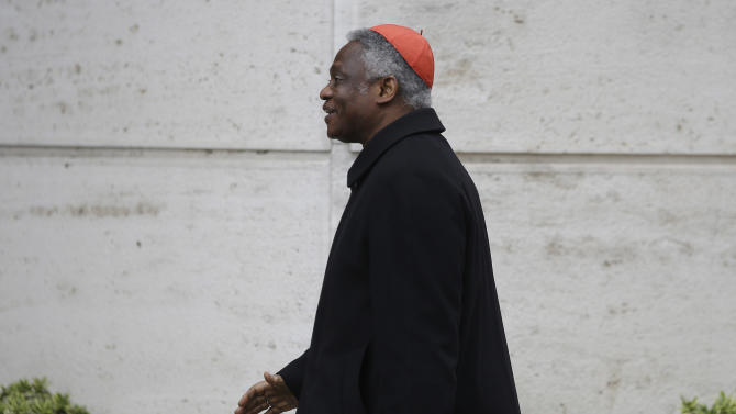 Nigerian Cardinal Peter Kodwo Appiah Turkson arrives at the Vatican, Thursday, March 7, 2013. Cardinals from around the world are  gathered inside the Vatican on the fourth day of meetings before the conclave to elect the next pope, amid scandals inside and out of the Vatican and the continued reverberations of Benedict XVI's decision to retire. (AP Photo/Gregorio Borgia)