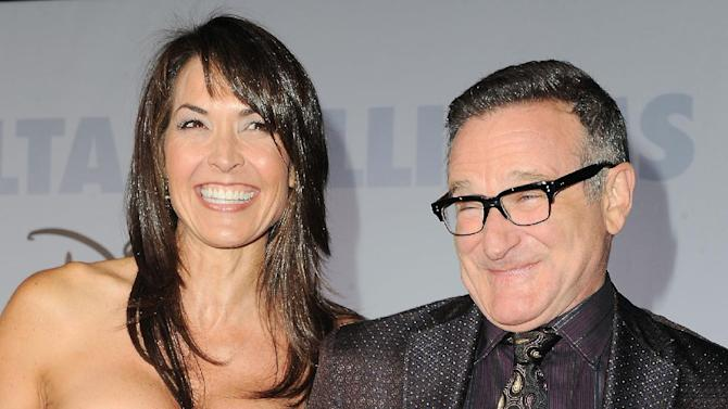 "FILE - This Nov. 9, 2009 file photo shows actor Robin Williams, right, and  his wife Susan Schneider at the premiere of ""Old Dogs"" in Los Angeles. Attorneys for Robin Williams' wife and children are headed to court in their battle over the late comedian's estate. The attorneys are scheduled to appear before a San Francisco probate judge on Monday, as they argue over who should get clothes and other personal items the actor kept at one his Northern California homes. In papers filed in December, Williams' wife, Susan, says some of the late actor's personal items were taken without her permission. She has asked the court to set aside the contents of the home she shared with Williams from the jewelry, memorabilia and other items Williams said the children should have. (AP Photo/Katy Winn, FIle)"