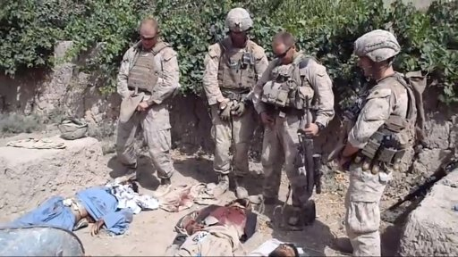 Video grab taken from an undated YouTube video showing what is believed to be US Marines urinating on the bodies of dead Taliban soldiers in Afghanistan