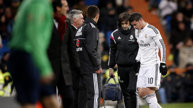FILE - In this Feb. 4, 2015 file picture James Rodriguez from Colombia, right, leaves the field injured during a La Liga soccer match between Real Madrid and Sevilla at the Santiago Bernabeu stadium in Madrid, Spain. The Colombian superstar returned to training Wednesday, March 4, 2015. (AP Photo/Daniel Ochoa de Olza, File)