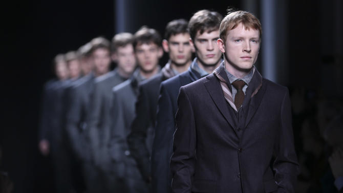 Models wear creations for Bottega Veneta men's Fall-Winter 2013-14 collection, part of the Milan Fashion Week, unveiled in Milan, Italy, Sunday, Jan. 13, 2013. (AP Photo/Luca Bruno)