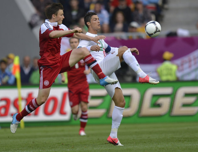 Denmark's William Kvist, left, and Portugal's Cristiano Ronaldo fight for possesion during the Euro 2012 soccer championship Group B match between Denmark and Portugal in Lviv, Ukraine, Wednesday, June 13, 2012.