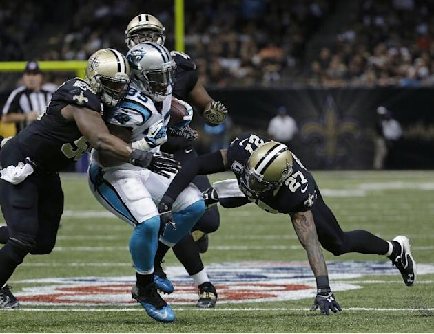 Carolina Panthers fullback Mike Tolbert (35) is tackled by New Orleans Saints middle linebacker Curtis Lofton (50) and free safety Malcolm Jenkins (27) in the second half of an NFL football game in Ne