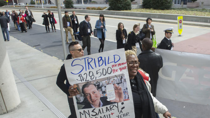 IMAGE DISTRIBUTED FOR AIDS HEALTHCARE FOUNDATION - Protesters from the Drug Pricing Forum including Sharron Fickling demonstrate against high drug prices, particularly Gilead the maker of Stribild and their CEO John Martin, outside the Conference on Retroviruses and Opportunistic Infections held at the Georgia World Congress Center on Monday, March 4, 2013, in Atlanta. AIDS Healthcare Foundation has joined with Citywide Project and HCV Coalition for the Cure to host a two day Drug Pricing Forum underway in Decatur, Ga. and running concurrently with CROI in Atlanta. (John Amis/AP Images for AIDS Healthcare Foundation)