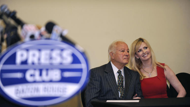 Former Louisiana Gov. Edwin Edwards, left, poses with wife Trina Scott Edwards, right, for photo, before speaking at the Baton Rouge Press Club, Monday, March 17, 2014, in Baton Rouge, La., announcing that he would join the race to represent the state's Baton Rouge-based 6th District of the U.S. House of Representatives. Edwards served two terms as governor in the 1970s. He was re-elected in 1983 and made another comeback for a fourth term in 1991. (AP Photo/Travis Spradling)