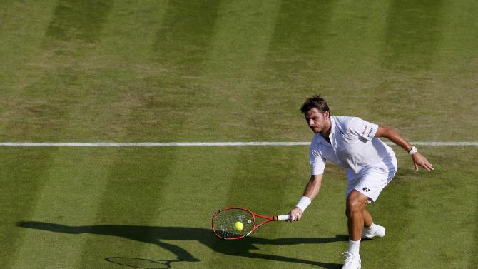 Stan Wawrinka of Switzerland plays a shot during his match against Victor Estrella Burgos of Dominican Republic at the Wimbledon Tennis Championships in London