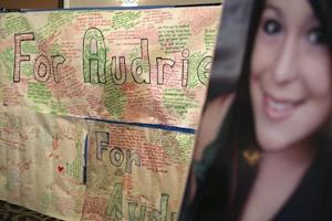 A message board and portrait of Audrie Pott are shown at a news conference in San Jose