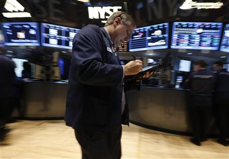 Traders work on the floor at the New York Stock Exchange, March 13, 2013. REUTERS/Brendan McDermid