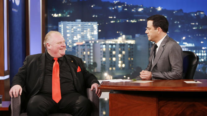 """FILE - This March 3, 2014 file image released by ABC shows Toronto Mayor Rob Ford, left, with host Jimmy Kimmel on the late night talk show """"Jimmy Kimmel Live,"""" in Los Angeles. Ford is claiming he wouldn't know Kevin Spacey """"if I ran over him,"""" a week after the House of Cards star poked fun at the mayor when both appeared on """"Jimmy Kimmel Live."""" (AP Photo/ABC, Randy Holmes, File)"""