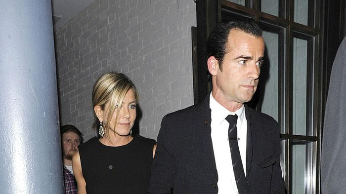 LOVED UP! Jennifer Aniston and new beau Justin Theroux spotted leaving Shoreditch House hand-in-hand - their first PDA!