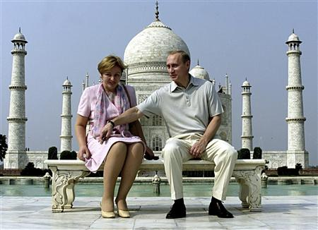 Russian President Vladimir Putin and his wife Lyudmila sit in front of the Taj Mahal while touring the city of Agra in this October 4, 2000 file photograph. REUTERS/Pawel Kopczynski/Files