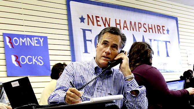 """FILE - In this Oct. 22, 2011 file photo, Republican presidential candidate, former Massachusetts Gov. Mitt Romney works with volunteers making calls while visiting his Romney For President New Hampshire Headquarters in Manchester, N.H.  Perhaps no presidential battleground will test the leanings of critical independent voters more than the """"Live Free or Die"""" state, the launching pad for Mitt Romney's White House bid. President Barack Obama won New Hampshire handily four years ago, but the former Massachusetts governor's ties run deep in a state that has vacillated between Republicans and Democrats in recent years.  (AP Photo/Cheryl Senter, File)"""
