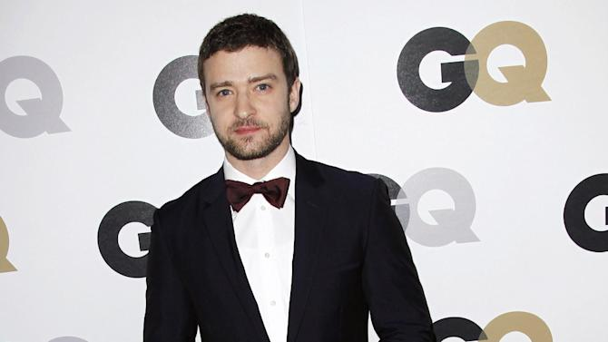 """FILE - This Nov. 17, 2011 file photo shows Honoree Justin Timberlake arrives at the 16th annual GQ """"Men of the Year"""" party in Los Angeles, Thursday, Nov. 17, 2011. The lyric video _ which features words onscreen while a song plays _ is not a new phenomenon in music. But these days, lyric videos are used to promote new songs, giving fans something to hold on to between a song's release and the launch of an official music video.Timberlake  recently released a lyric video for his new single, """"Suit & Tie.""""  (AP Photo/Matt Sayles)"""